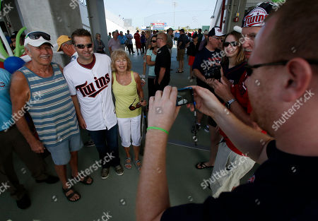 Brian Dozier Brian Dozier, center, poses for a photo as he greets fans at the front gates of Hammond Stadium during a Twins open house event at baseball spring training in Fort Myers Fla