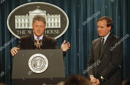 Bill Clinton, Michael McCurry U.S. President Bill Clinton gestures in the White House briefing room in Washington, where he announced that Michael McCurry, right, would become White House press secretary. McCurry, 40, formerly State Department spokesman, would replace Dee Dee Myers who resigned at the end of last year