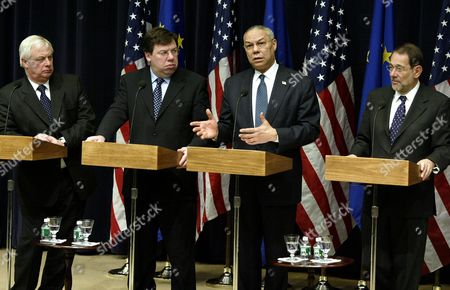 SOLANA Secretary of State Colin Powell, third from left, gestures during a press conference as, from left, European Union External Affairs Commissioner Christopher Patten, European Union President and Irish Foreign Minister Brian Cowen, and Secretary General of the European Union Javier Solana watch on in Washington. The European Union delegation met with Powell to chiefly discuss E.U.-U.S. relations, the Middle East, and Iraq