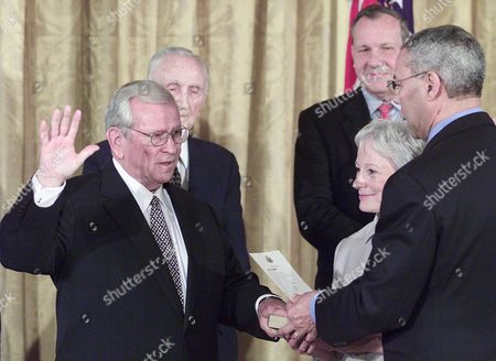 POWELL Former Senator Howard Baker, left, is sworn in as the new ambassador to Japan, by Secretary of State Colin Powell, right, Baker's wife former Senator Nancy Kassenbaum Baker and former ambassadors to Japan Mike Mansfield, left, and Michael Armacost, right, look on. President Bush attended the event at the White House