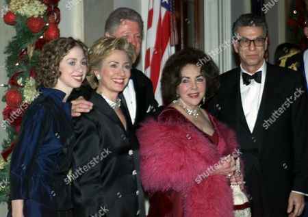 CLINTON TAYLOR ZAHEDI President Bill Clinton, first lady Hillary Rodham Clinton and their daughter, Chelsea, pose with actress Elizabeth Taylor, second from right, and escort Firooz Zahedi at the White House in Washington, D.C., during a black tie dinner for more than 300 guests in celebration of the millennium