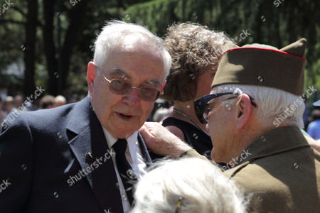 Dirk Kruysman, left, talks with D-Day veteran Frank Moore on in Salem, Ore. At least 1,000 veterans and their families, including many World War II veterans, came to the grounds of the state Capitol on the 70th anniversary of D-Day for the dedication of a new memorial honoring Oregonians who served during the war