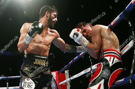 Anthony Crolla and Jorge Linares during the WBA, WBC Diamond and Ring Magazine Lightweight World Titles fight at the Two Worlds Collide fight night at the MEN Arena, Manchester on 24th September 2016