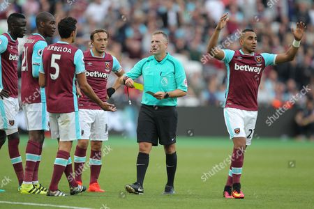Alvaro Arbeloa of West Ham United is shown a yellow card by Referee Jonathan Moss   during the Premier League match between West Ham United and Southampton  played at The London  Stadium , London  on 25th September 2016