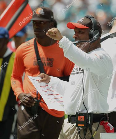 Hue Jackson, Robert Griffin III Cleveland Browns head coach Hue Jackson gestures as injured quarterback Robert Griffin III walks the sidelines during an NFL football game, in Miami Gardens, Fla