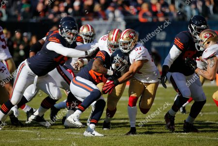 Matt Forte, Quinton Dial, Michael Wilhoite Chicago Bears running back Matt Forte (22) is tackled by San Francisco 49ers defensive end Quinton Dial (92) and linebacker Michael Wilhoite (57) during the first half of an NFL football game, in Chicago