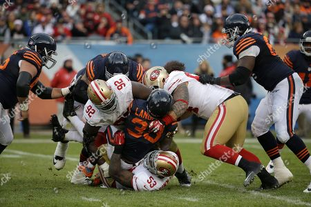 Jeremy Langford, Quinton Dial, NaVorro Bowman, Mike Purcell Chicago Bears running back Jeremy Langford (33) is tackled by San Francisco 49ers defensive end Quinton Dial (92), linebacker NaVorro Bowman (53) and tackle Mike Purcell (64) during the second half of an NFL football game, in Chicago