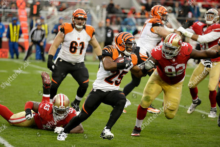 Giovani Bernard, Quinton Dial Cincinnati Bengals running back Giovani Bernard (25) runs against San Francisco 49ers defensive end Quinton Dial (92) during the second half of an NFL football game in Santa Clara, Calif