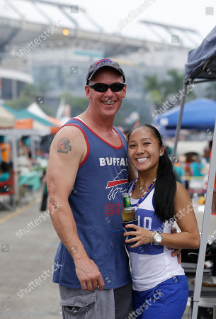 Stock Picture of Jason Serak, Amy Chu Amy Chu of Miami and Jason Serak of Coral Springs, Fla., tailgate before an NFL football game against the Buffalo Bills, in Miami Gardens, Fla