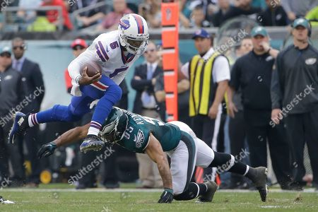 Tyrod Taylor, Mychal Kendricks, Walter Thurmond Buffalo Bills' Tyrod Taylor, left, tries to leap past a tackle from Philadelphia Eagles' Mychal Kendricks during the first half of an NFL football game, in Philadelphia