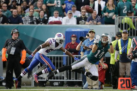 Riley Cooper, Leodis McKelvin Philadelphia Eagles' Riley Cooper, right, dives for an incomplete pass against Buffalo Bills' Leodis McKelvin during the first half of an NFL football game, in Philadelphia