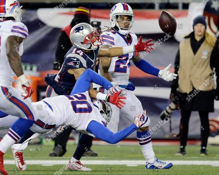 Chris Harper, Stephon Gilmore, Corey Graham New England Patriots wide receiver Chris Harper (14) and Buffalo Bills defensive backs Stephon Gilmore (24) and Corey Graham (20) contend for a pass in the second half of an NFL football game, in Foxborough, Mass. Gilmore intercepted it