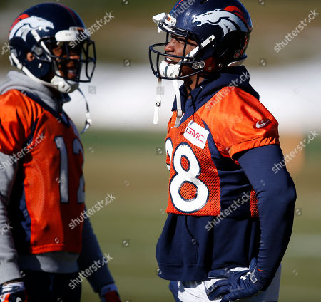 Demaryius Thomas, Andre Caldwell Denver Broncos wide receivers Demaryius Thomas, right, and Andre Caldwell joke with each other during an NFL football practice, at the team's headquarters in Englewood, Colo