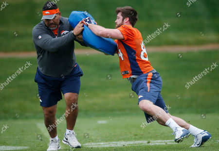 Henry Krieger-Coble, Luther Elliss Denver Broncos rookie tight end Henry Krieger-Coble, right, squares off during a drill with the team's chaplain Luther Elliss during NFL football rookie camp football, in the team's headquarters in Englewood, Colo