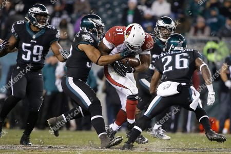 David Johnson, Brandon Graham, Walter Thurmond Arizona Cardinals' David Johnson (31) tries to break past Philadelphia Eagles' Brandon Graham (55) and Walter Thurmond (26) during the second half of an NFL football game against the Philadelphia Eagles, in Philadelphia