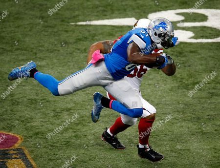 Calvin Johnson Detroit Lions wide receiver Calvin Johnson (81) is stopped by Arizona Cardinals outside linebacker LaMarr Woodley (56) during the first half of an NFL football game, in Detroit