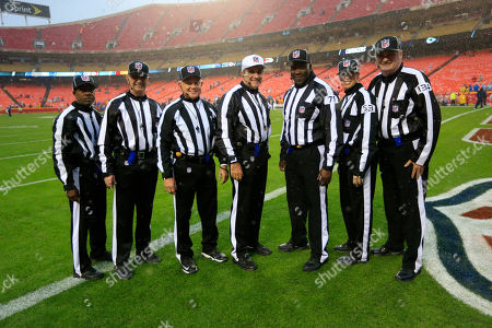 Dale Shaw, Rob Vernatchi, Rick Patterson, Peter Morelli, Ruben Fowler, Sarah Thomas, Ed Camp NFL officials pose before an NFL football game between the Kansas City Chiefs and the San Diego Chargers in Kansas City, Mo., . From left: back judge Dale Shaw, side judge Rob Vernatchi, side judge Rick Patterson, referee Peter Morelli, umpire Ruben Fowler, line judge Sarah Thomas and head linesman Ed Camp