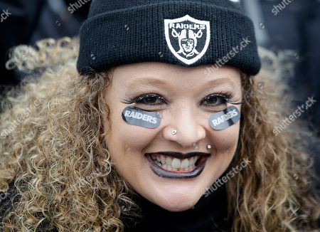 Oakland Raiders fan Sarah Powell poses for photos while tailgating at O.co Coliseum before an NFL football game between the Oakland Raiders and the San Diego Chargers in Oakland, Calif