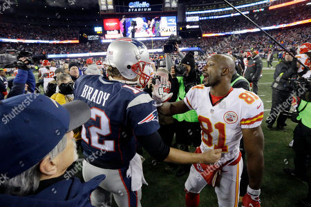 Tom Brady, Jason Avant New England Patriots quarterback Tom Brady (12) greets Kansas City Chiefs wide receiver Jason Avant (81) after an NFL divisional playoff football game, in Foxborough, Mass. The Patriots won, 27-20