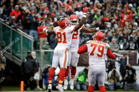Donald Stephenson, Spencer Ware, Jason Avant Kansas City Chiefs running back Spencer Ware, center, celebrates with wide receiver Jason Avant (81) and tackle Donald Stephenson (79) after scoring on a touchdown run against the Oakland Raiders during the second half of an NFL football game in Oakland, Calif