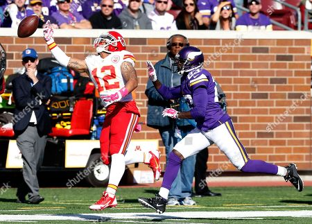Albert Wilson, Terence Newman Kansas City Chiefs wide receiver Albert Wilson (12) cannot catch a pass as Minnesota Vikings cornerback Terence Newman (23) defends during the second half of an NFL football game, in Minneapolis