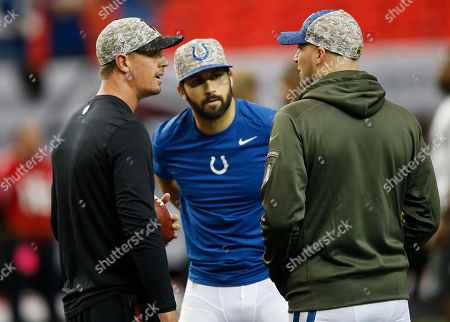 Atlanta Falcons quarterback Matt Ryan, right, Indianapolis Colts quarterback Matt Hasselbeck, right, and Indianapolis Colts quarterback Charlie Whitehurst, speak while wearing Salute to Service caps before the first of an NFL football game between the Atlanta Falcons and the Indianapolis Colts, in Atlanta