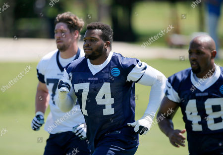 Lawrence Okoye, Bryan Witzmann, Brandon Hepburn Dallas Cowboys' Lawrence Okoye (74) of the United Kingdom, Bryan Witzmann, left rear, and Brandon Hepburn (48) jog as they work out during an NFL football training camp, in Irving, Texas