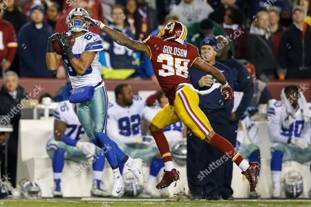 Dashon Goldson, Terrance Williams Dallas Cowboys wide receiver Terrance Williams (83) pulls in a pass under pressure form Washington Redskins free safety Dashon Goldson (38) during the first half of an NFL football game in Landover, Md