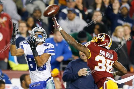 Dashon Goldson, Terrance Williams Dallas Cowboys wide receiver Terrance Williams (83) pulls in a pass under pressure from Washington Redskins free safety Dashon Goldson (38) during the first half of an NFL football game in Landover, Md