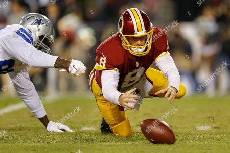 Kirk Cousins, Demarcus Lawrence Washington Redskins quarterback Kirk Cousins (8) dives on his own fumble after a sack by Dallas Cowboys defensive end Demarcus Lawrence (90) during the first half of an NFL football game in Landover, Md