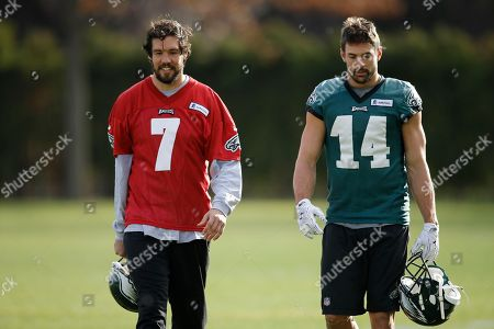 Stock Photo of Sam Bradford, Riley Cooper Philadelphia Eagles quarterback Sam Bradford (7) and wide receiver Riley Cooper (14) walk off the field at the NFL football team's practice facility, in Philadelphia