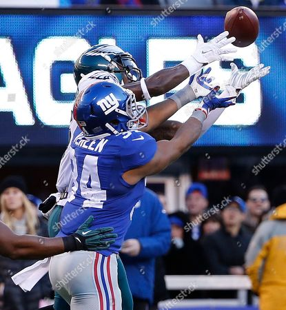 Philadelphia Eagles strong safety Walter Thurmond (26) intercepts a pass intended for New York Giants running back Shane Vereen (34) as Philadelphia Eagles inside linebacker DeMeco Ryans (59) looks on during the third quarter of an NFL football game, in East Rutherford, N.J. Thurmond ran the interception 85 yards back for a touchdown