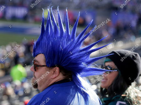 James Martinez watches player warmups before an NFL football game between the Philadelphia Eagles and the New York Giants, in East Rutherford, N.J