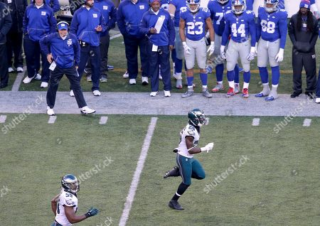 Stock Photo of Philadelphia Eagles strong safety Walter Thurmond (26) runs an interception back for a touchdown against the New York Giants during the third quarter of an NFL football game, in East Rutherford, N.J