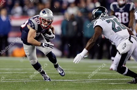Danny Amendola, Walter Thurmond New England Patriots wide receiver Danny Amendola (80) runs from Philadelphia Eagles safety Walter Thurmond (26) after catching a pass during the first half of an NFL football game, in Foxborough, Mass