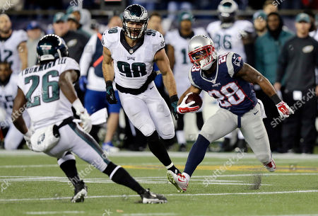 James White, Walter Thurmond, Connor Barwin New England Patriots running back James White (28) tries to elude Philadelphia Eagles safety Walter Thurmond (26) and linebacker Connor Barwin (98) during the second half of an NFL football game, in Foxborough, Mass