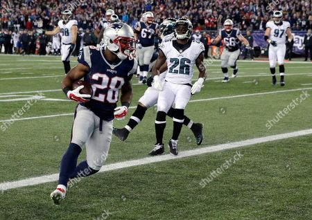 James White New England Patriots running back James White (28) scores a touchdown in front of Philadelphia Eagles safety Walter Thurmond (26) after catching a pass from Tom Brady during the first half of an NFL football game, in Foxborough, Mass