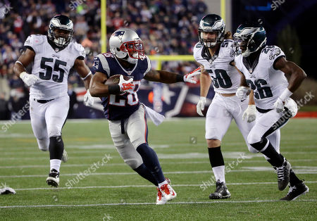 James White, Brandon Graham, Kiko Alonso, Walter Thurmond New England Patriots running back James White (28) runs from Philadelphia Eagles linebackers Brandon Graham (55), Kiko Alonso (50), and safety Walter Thurmond (26) during the second half of an NFL football game, in Foxborough, Mass