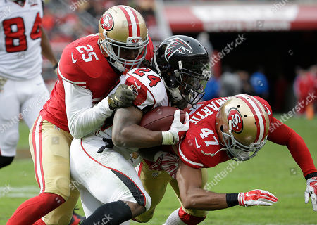 Devonta Freeman, Jimmie Ward, Marcus Cromartie Atlanta Falcons running back Devonta Freeman (24) is tackled by San Francisco 49ers strong safety Jimmie Ward (25) and defensive back Marcus Cromartie (47) during the first half of an NFL football game in Santa Clara, Calif