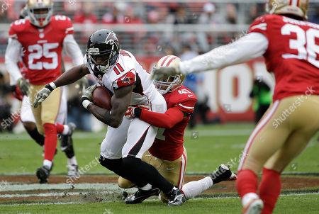 Julio Jones, Marcus Cromartie Atlanta Falcons wide receiver Julio Jones (11) is tackled by San Francisco 49ers defensive back Marcus Cromartie (47) during an NFL football game in Santa Clara, Calif
