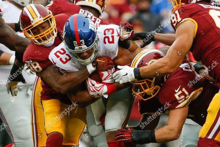 Dashon Goldson, Rashad Jennings, Will Compton New York Giants running back Rashad Jennings (23) is stopped by Washington Redskins free safety Dashon Goldson (38) and inside linebacker Will Compton (51) during the first half of an NFL football game in Landover, Md