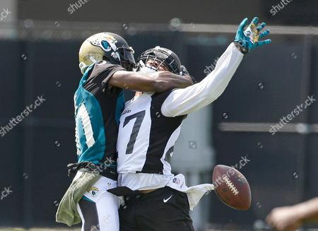 Marqise Lee, Dwayne Gratz Jacksonville Jaguars cornerback Dwayne Gratz, right, breaks up a pass intended for wide receiver Marqise Lee, left, during an NFL football practice, in Jacksonville, Fla