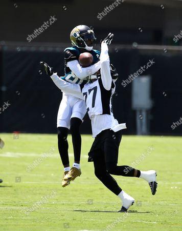Jacksonville Jaguars cornerback Dwayne Gratz (27) breaks up a pass intended for wide receiver Allen Hurns during NFL football training camp, in Jacksonville, Fla