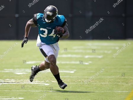 Jacksonville Jaguars running back Jonas Gray runs during a scrimmage at NFL football training camp, in Jacksonville, Fla