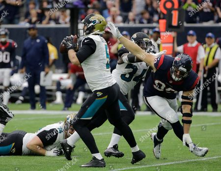 J.J. Watt Houston Texans defensive end J.J. Watt (99) is blocked by Jacksonville Jaguars running back Jonas Gray (34) as he rushes quarterback Blake Bortles (5) during the second half an NFL football game, in Houston