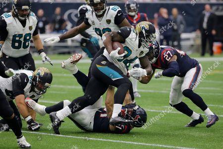 Jonas Gray Jacksonville Jaguars running back Jonas Gray (34) makes a run against the Houston Texans during the first half an NFL football game, in Houston