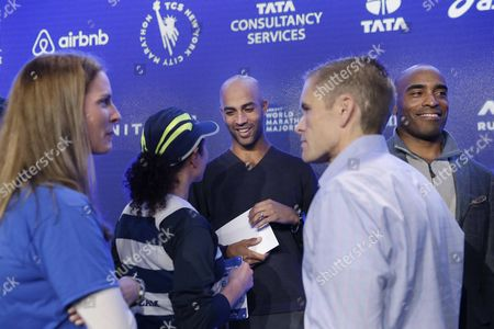 James Blake, Tiki Barber Former tennis star James Blake, center rear, and former NFL player Tiki Barber, right, talk with runners during a news conference in New York, . Blake and Barber are planning to take part in the New York City Marathon on Sunday, Nov. 1, 2015