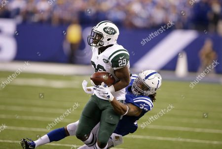 Bilal Powell, Dwight Lowery Indianapolis Colts free safety Dwight Lowery (33) tackles New York Jets running back Bilal Powell (29) in the first half of an NFL football game in Indianapolis