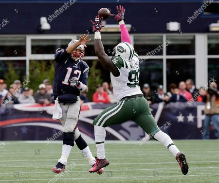 Muhammad Wilkerson, Tom Brady New England Patriots quarterback Tom Brady (12) passes over New York Jets defensive end Muhammad Wilkerson (96) during the second half of an NFL football game, in Foxborough, Mass