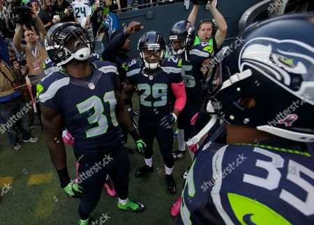 "Richard Sherman Seattle Seahawks ""Legion of Boom"" defensive players including Kam Chancellor (31) and Earl Thomas (29) huddle before taking the field before an NFL football game against the Detroit Lions, in Seattle. Both teams are wearing pink items for breast cancer awareness during the game"